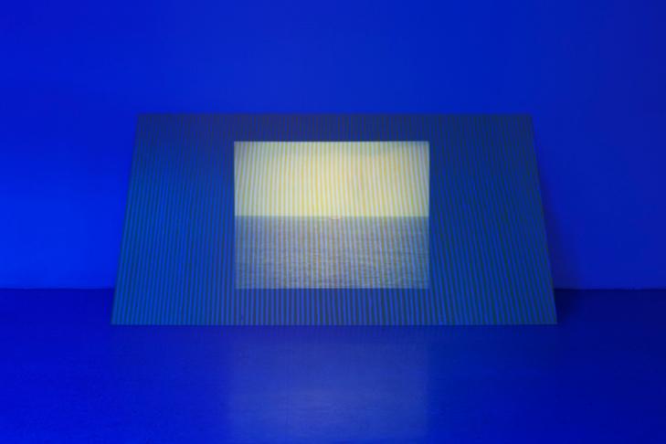 Passage (2011), window tint, 35mm slide projection, sheetrock, tempera, 4 x 8 feet